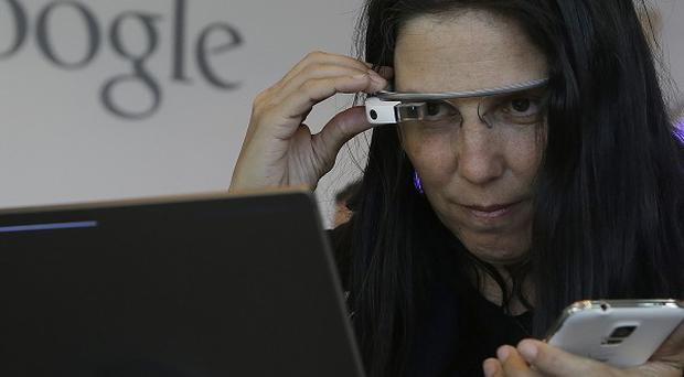Cecilia Abadie uses Google Glass as she registers for Google I/O 2014 in San Francisco (AP)