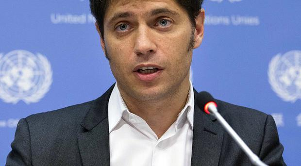Argentine economic minister Axel Kicillof speaks during a news conference at UN headquarters (AP)