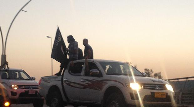 ISIL fighters parade in Iraq's second largest city Mosul (AP)