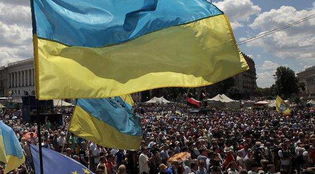 People gather for a rally in Independence Square in Kiev, Ukraine, to demand an end to the cease fire (AP)