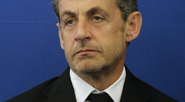 Nicolas Sarkozy was detained for questioning at the headquarters of the judicial police in Paris (AP/Lionel Cironneau)