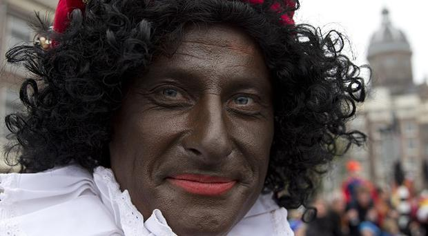 Black Pete is a negative stereotype of black people, an Amsterdam court has ruled (AP)