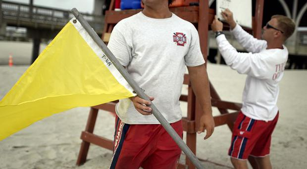 Lifeguards on on Tybee Island, Georgia, warn swimmers of strong rip currents from Hurricane Arthur (AP/Stephen B Morton)