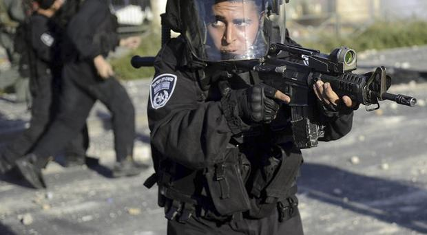 An Israeli border policeman during clashes with Palestinians in Jerusalem (AP Photo/Mahmoud Illean)
