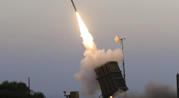 An Iron Dome air defence system fires to intercept a rocket from Gaza Strip