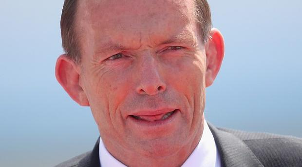 Prime Minister Tony Abbott's government has confirmed it screened asylum seekers at sea and returned them directly to their home country for the first time