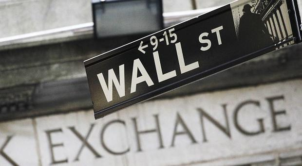 The Dow Jones industrial average ended lower after reaching record highs last week (AP)
