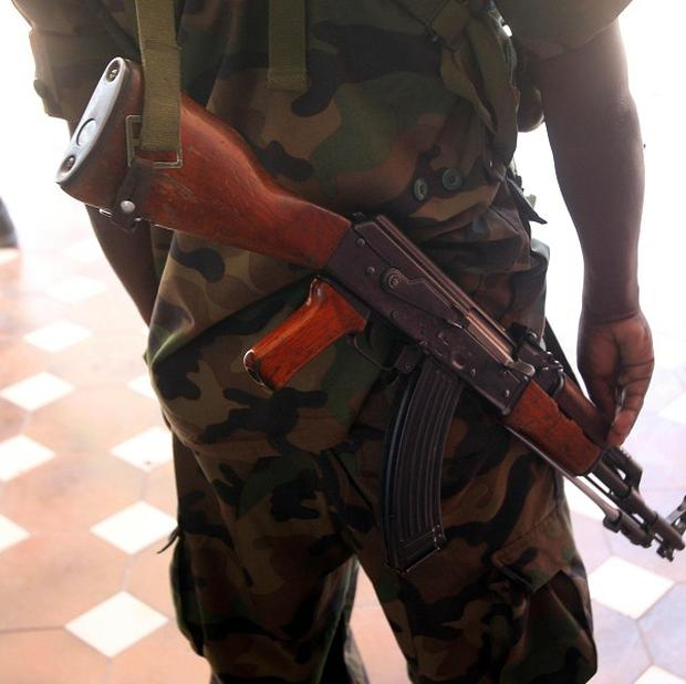 An armed guard on duty outside the presidential palace in Mogadishu