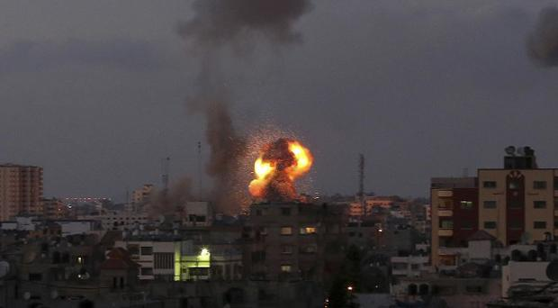 Smoke and a ball of fire rises after an Israeli missile strike in Beit Lahia, northern Gaza Strip (AP)
