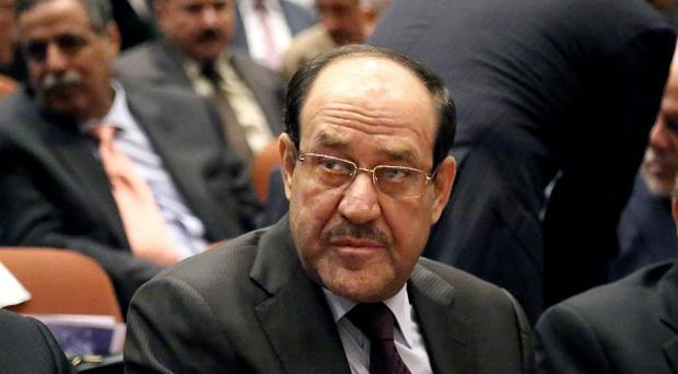 Prime Minister Nouri al-Maliki, centre, accused the Kurds of harbouring militants in Iraq (AP)