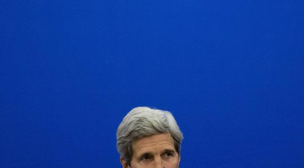John Kerry made a hastily arranged visit to Afghanistan to help resolve the election crisis (AP)