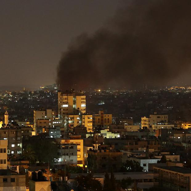 Smoke rises after an Israeli strike in Gaza City (AP)