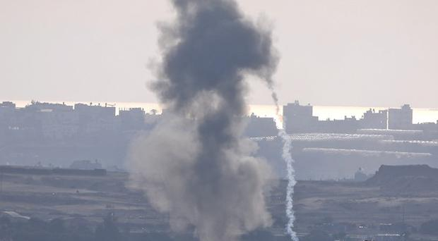 A failed rocket launch by Palestinian militants towards Israel, after it crashed, as seen from the Israel-Gaza border (AP)