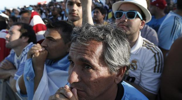 Argentina fans watch the World Cup Final inside the FIFA Fan Fest area on Copacabana beach (AP)