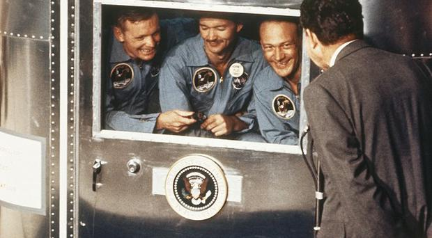 President Richard Nixon greeting Apollo 11 astronauts Neil Armstrong, Michael Collins and Buzz Aldrin after splashdown and recovery in 1969 (AP)
