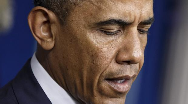 US president Barack Obama has described the downing of the Malaysia Airlines plane as an 'outrage of unspeakable proportions' (AP)