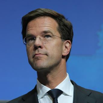 Mark Rutte says he was shocked by images of rebels picking through the belongings of victims at the crash scene