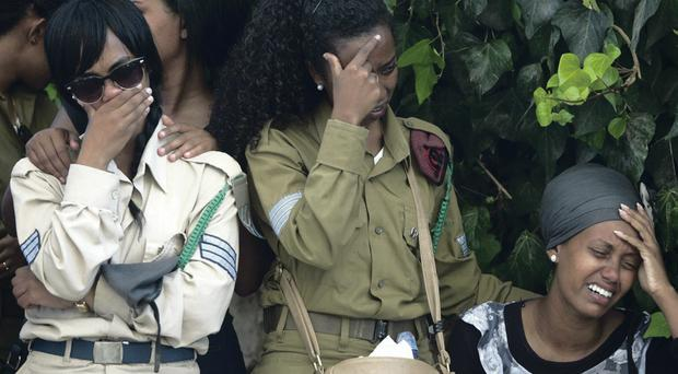 Israeli soldiers and friends weep during the funeral of Israeli soldier Moshe Malko who was killed during the operation 'Protective Edge'