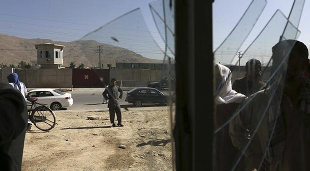 A shop's windows were damaged in the blast at a police compound in Kabul, Afghanistan (AP)