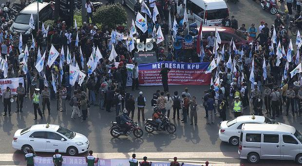 Supporters of Indonesian presidential candidate Prabowo Subianto hold banners in a protest Jakarta. (AP)
