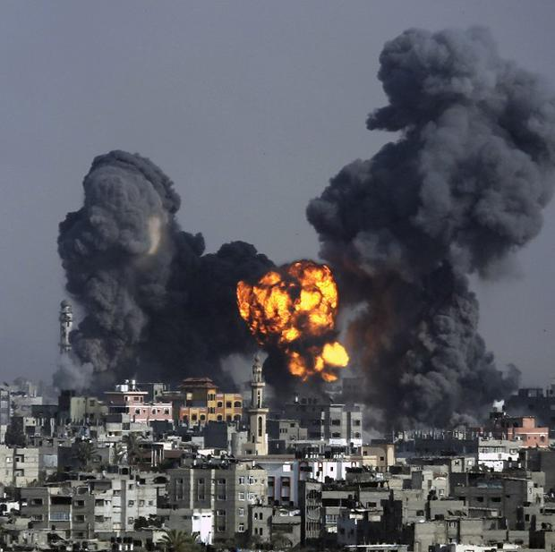 Smoke and fire from the explosion of an Israeli strike rise over Gaza City (AP)
