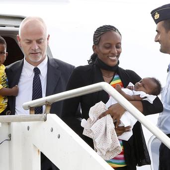 Meriam Ibrahim, from Sudan, disembarks with her family at Ciampino's military airport on the outskirts of Rome (AP)