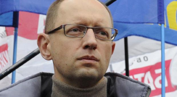 Arseniy Yatsenyuk announced his resignation as PM (AP)