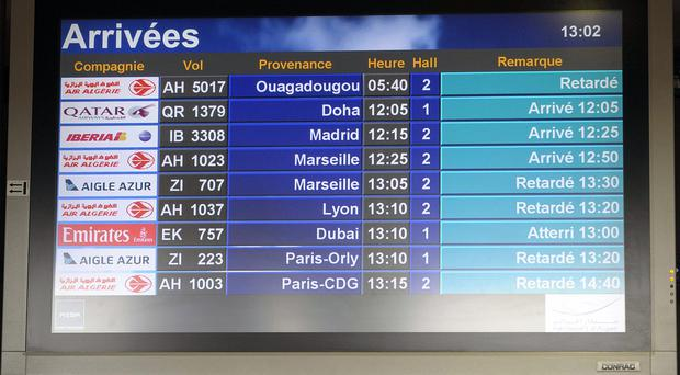 An arrival information screen shows the delayed Air Algerie flight 5017 (top) at the Houari Boumediene airport near Algiers (AP)