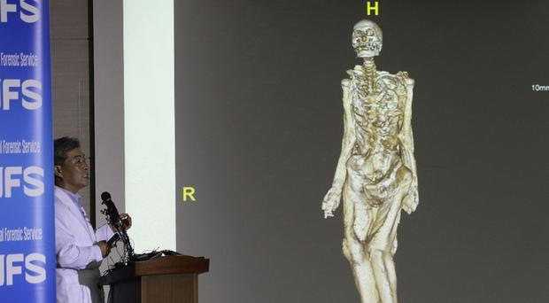 Lee Han-young of the South Korea National Forensic Service briefs the media in Seoul (AP)