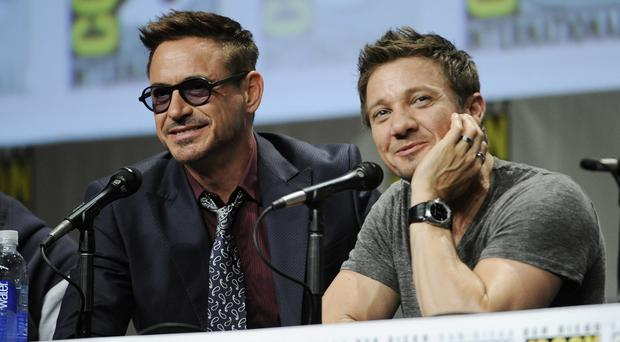 Robert Downey Jr and Jeremy Renner at ComicCon in San Diego (AP)