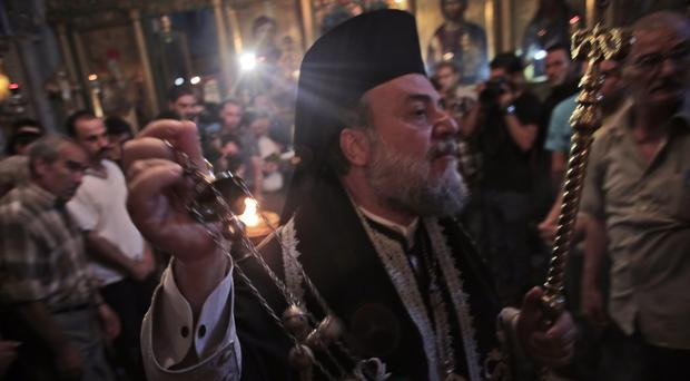 Archbishop Alexios of Gaza during the funeral of Christian woman Jalila Ayyad, who was killed in an Israeli airstrike (AP)