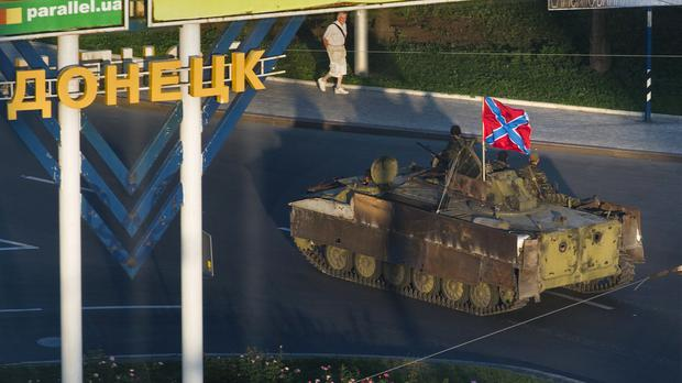 A Donetsk People's Republic APC travels in the city of Donetsk (AP)
