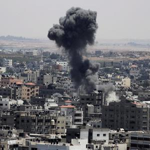 Smoke from an Israeli strike rises over the northern Gaza Strip on Sunday, July 27 (AP Photo/Adel Hana)