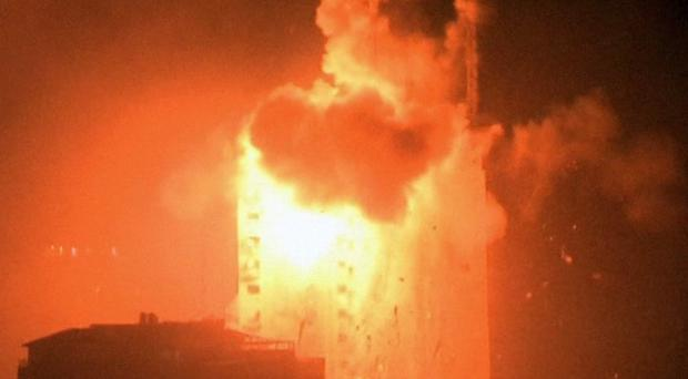 An explosion hits the media complex housing the offices of Hamas-run Al Aqsa television and radio in central Gaza City (AP/APTN)