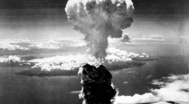 A mushroom cloud towers over Nagasaki, after the atomic bombing on August 9, 1945 (US Air Force Photo / PA)