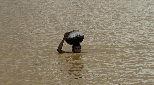 India's monsoon season bring rains that are vital to agriculture but also cause floods and landslides. (AP)