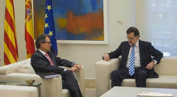 Catalonia's regional president Artur Mas, left, talks to Spain's premier Mariano Rajoy. (AP Photo/Andres Kudacki)