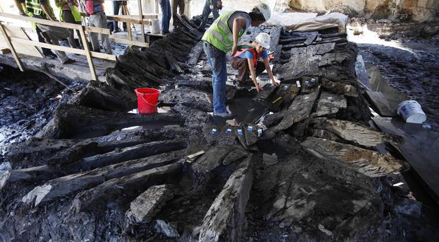 Archaeologists dismantle the remains of the 18th-century ship at the World Trade Centre site (AP)