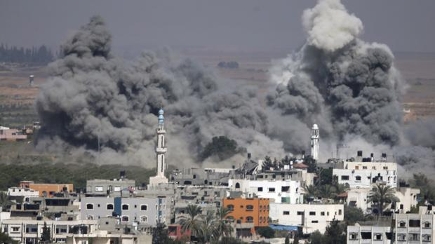 Smoke rises after another Israeli strike in Gaza City (AP)