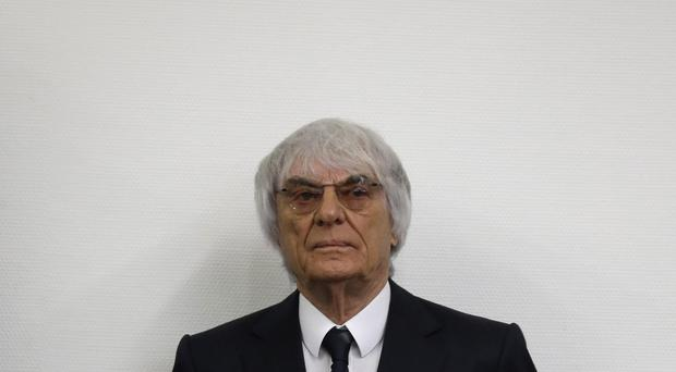 Formula One boss Bernie Ecclestone arrives for his bribery trial in the regional court in Munich, southern Germany (AP Photo/Matthias Schrader)