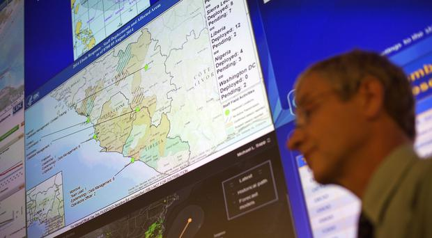 Steve Monroe, deputy director of the National Centre for Emerging and Zoonotic Infectious Diseases at the US Centres for Disease Control and Prevention, at the agency's emergency operations centre in Atlanta (AP)