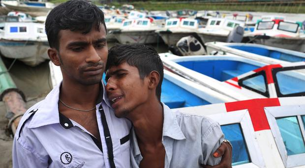 A Bangladeshi boy cries for his missing family members, victims of the ferry capsize in Bangladesh (AP)