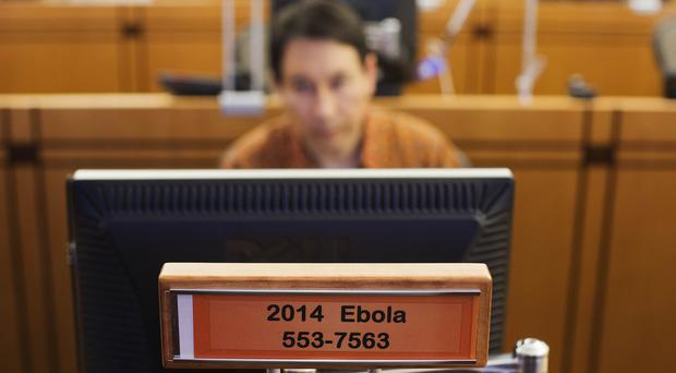A sign designates a workstation dedicated to Ebola in the Emergency Operations Centre at the US Centres for Disease Control and Prevention (AP)