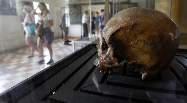 The skull of a genocide victim on display at the Tuol Sleng Genocide Museum in Phnom Penh (AP)