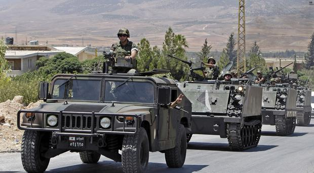 Lebanese army reinforcements arrive at the outskirts of Arsal, a town near the Syrian border (AP)