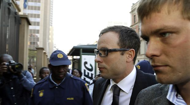 Oscar Pistorius arrives at the high court in Pretoria, South Africa (AP)