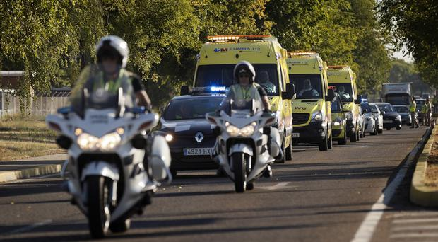An ambulance transporting a Spanish priest with the Ebola virus leaves the Military Air Base of Torrejon de Ardoz, near Madrid in Spain (AP)