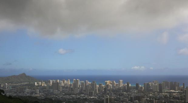 Clouds hang over Honolulu, as Hawaii is expected to take its first direct hurricane hit in 22 years (AP)