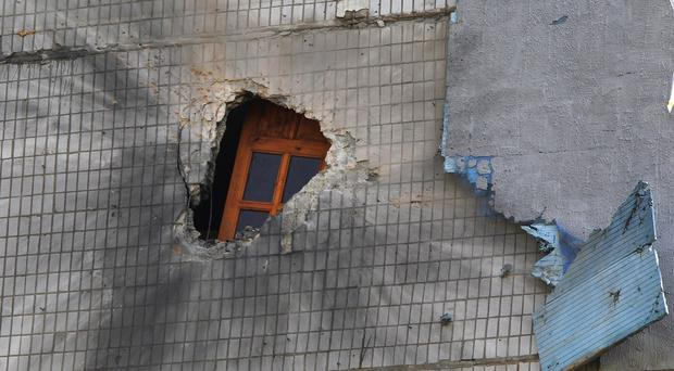 Damage caused by a shell on the side of an apartment building in Donetsk, eastern Ukraine (AP)