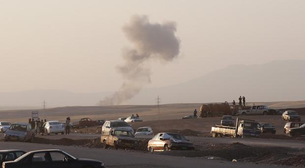 Smoke rises after airstrikes targeting Islamic State militants near the Khazer checkpoint outside Irbil (AP)